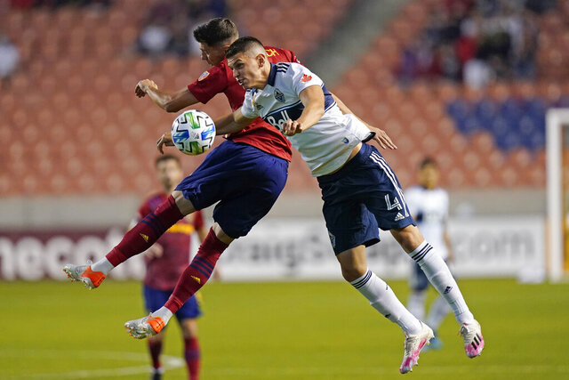 Real Salt Lake midfielder Damir Kreilach, rear, defends against Vancouver Whitecaps defender Ranko Veselinovic (4) in the first half during an MLS soccer match Saturday, Sept. 19, 2020, in Sandy, Utah. (AP Photo/Rick Bowmer)
