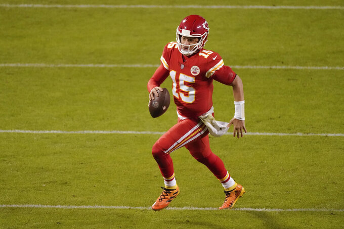 Kansas City Chiefs quarterback Patrick Mahomes runs the ball against the Denver Broncos in the second half of an NFL football game in Kansas City, Mo., Sunday, Dec. 6, 2020. (AP Photo/Charlie Riedel )