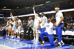 Memphis' James Wiseman (second from right) goes down on his knees as he and his teammates celebrate a basket in the second half of an NCAA college basketball game against Alcorn State Saturday, Nov. 16, 2019, in Memphis, Tenn. (AP Photo/Karen Pulfer Focht)