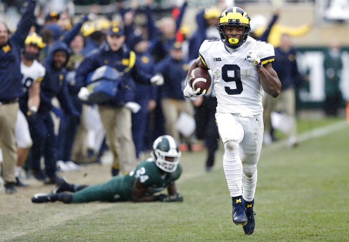Michigan wide receiver Donovan Peoples-Jones (9) runs for a 79-yard touchdown run during the second half of an NCAA college football game against Michigan State, Saturday, Oct. 20, 2018, in East Lansing, Mich. (AP Photo/Carlos Osorio)