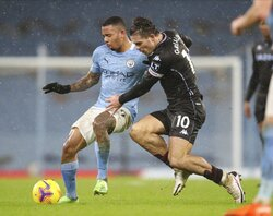 Aston Villa's Jack Grealish, right, and Manchester City's Gabriel Jesus challenge for the ball during the English Premier League soccer match between Manchester City and Aston Villa at the Etihad Stadium in Manchester, England, Wednesday, Jan.20, 2021. (Clive Brunskill/Pool via AP)