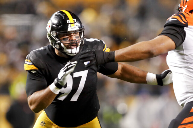 FILE - In this Dec. 30, 2018, file photo, Pittsburgh Steelers defensive end Cameron Heyward (97) plays against the Cincinnati Bengals in an NFL football gamein Pittsburgh. Heyward isn't sure what his future holds. The club hasn't contacted the Pro Bowler about an extension as he enters the final year of his current deal. (AP Photo/Don Wright, File)