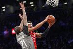 Brooklyn Nets forward Wilson Chandler (21) defends as Toronto Raptors forward Patrick McCaw (22) goes up for a layup during the first quarter of an NBA basketball game, Wednesday, Feb. 12, 2020, in New York. (AP Photo/Kathy Willens)