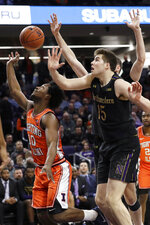 Illinois guard Andres Feliz, left, shoots next to Northwestern center Ryan Young during the first half of an NCAA college basketball game in Evanston, Ill., Thursday, Feb. 27, 2020. (AP Photo/Nam Y. Huh)