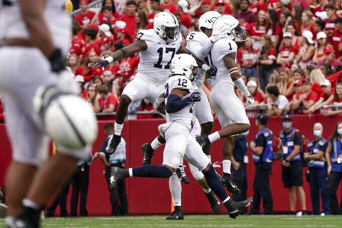 Penn State's Jaquan Brisker celebrates his interception during the second half of an NCAA college football game against Wisconsin Saturday, Sept. 4, 2021, in Madison, Wis. Penn State won 16-10. (AP Photo/Morry Gash)