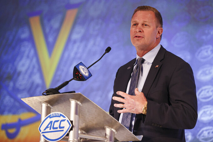 FILE - Virginia head coach Bronco Mendenhall answers a question during an NCAA college football news conference at the Atlantic Coast Conference media days in Charlotte, N.C., in this Wednesday, July 21, 2021, file photo. (AP Photo/Nell Redmond)