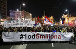 People hold a banner that reads: ''#1 out of 5 million'' during a protest in Belgrade, Serbia, Saturday, March 16, 2019. Thousands of people have rallied in Serbia's capital for 15th week in a row against populist President Aleksandar Vucic and his government. (AP Photo/Darko Vojinovic)