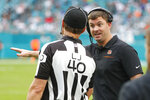 Cincinnati Bengals head coach Zac Taylor talks to umpire Butch Hannah (40), during the second half at an NFL football game against the Miami Dolphins, Sunday, Dec. 22, 2019, in Miami Gardens, Fla. (AP Photo/Wilfredo Lee)