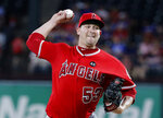 FILE - In this Tuesday, July 2, 2019 file photo, Los Angeles Angels starting pitcher Trevor Cahill throws to the Texas Rangers during a baseball game in Arlington, Texas. The Giants agreed to a minor league contract with right-hander Trevor Cahill, and he participated in the first spring training workout for pitchers and catchers, Wednesday, Feb. 12, 2020.(AP Photo/Tony Gutierrez, File)