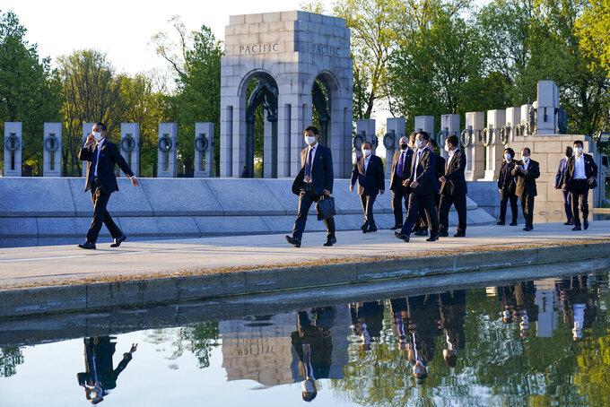 Japanese Prime Minister Yoshihide Suga visits the World War II Memorial, Saturday, April 17, 2021, in Washington. (AP Photo/Alex Brandon)