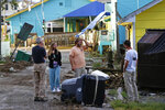 Residents survey the damages along the waterfront following the effects of Hurricane Isaias in Southport, N.C., Tuesday, Aug. 4, 2020. (AP Photo/Gerry Broome)