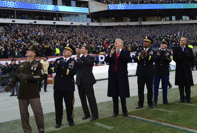 President Donald Trump, center, watches a flyover before the start of the Army-Navy NCAA college football game in Philadelphia, Saturday, Dec. 8, 2018. Army Chief of Staff Gen. Mark Milley watches second from left. (AP Photo/Susan Walsh)