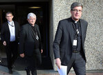 French bishop Eric de Moulins Beaufort, right, arrives to a press conference in Lourdes, southwestern France, Saturday, Nov. 9, 2019. 120 bishops are convening for their biannual assembly in Lourdes, where they will discuss the plan for a