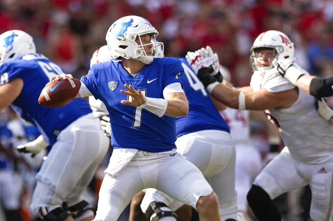 Buffalo quarterback Kyle Vantrease (7) sets up a pass against Nebraska during the second half of an NCAA college football game Saturday, Sept. 11, 2021, at Memorial Stadium in Lincoln, Neb. (AP Photo/Rebecca S. Gratz)
