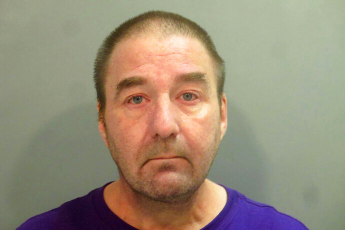 FILE - In this Aug. 17, 2019 file photo provided by the Washington County, Arkansas Sheriff's Department, Robert Levy is pictured in a booking photo. Levy, a pathologist fired from an Arkansas veterans hospital after officials said he had been impaired while on duty has been charged with involuntary manslaughter in the deaths of three patients who authorities say he misdiagnosed and whose records he later altered to conceal his mistakes. (Washington County Sheriff's Department via AP, File)