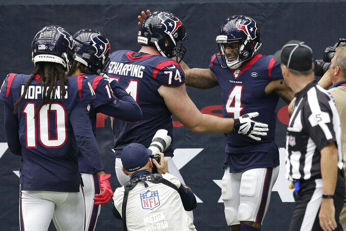 Houston Texans quarterback Deshaun Watson (4) celebrates his touchdown run against the Carolina Panthers during the second half of an NFL football game Sunday, Sept. 29, 2019, in Houston. (AP Photo/Michael Wyke)
