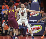 Illinois forward Giorgi Bezhanishvili (15) defends against Minnesota forward Eric Curry (24) during the first half of an NCAA college basketball game in Champaign, Ill., Wednesday, Jan. 16, 2019. (AP Photo/Rick Danzl)