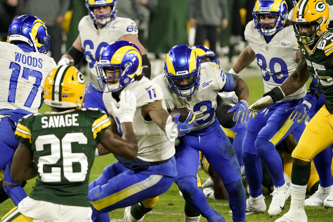 Los Angeles Rams' Cam Akers (23) runs for a seven-yard touchdown against the Green Bay Packers during the second half of an NFL divisional playoff football game Saturday, Jan. 16, 2021, in Green Bay, Wis. (AP Photo/Morry Gash)