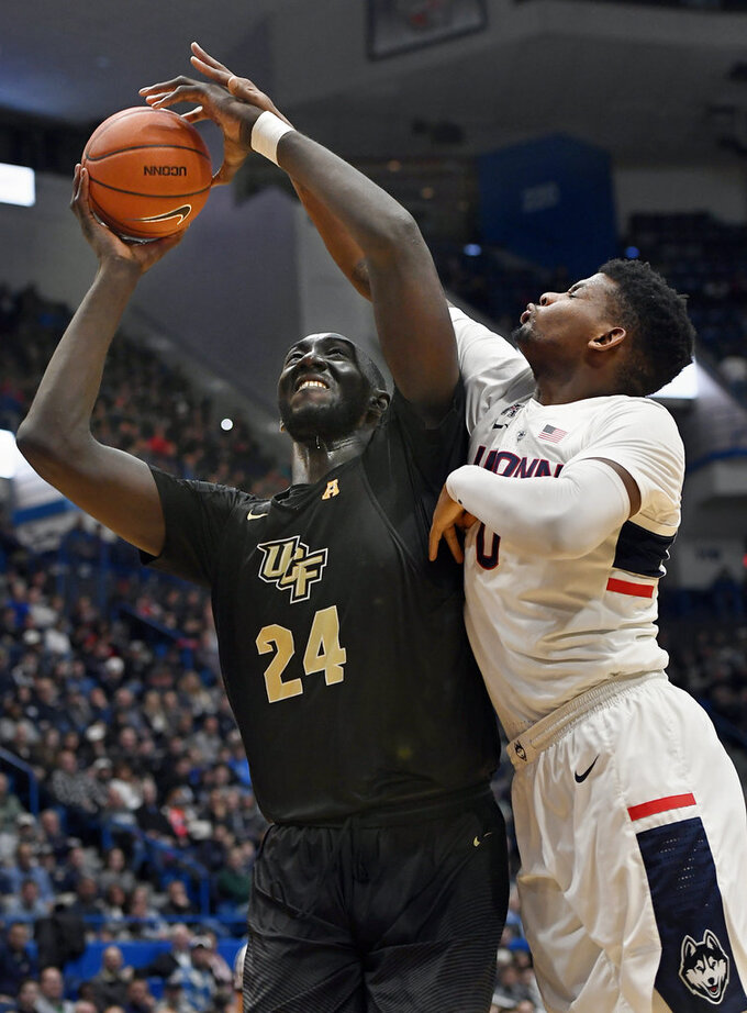 Dawkins scores 23 points and UCF beats UConn on the road