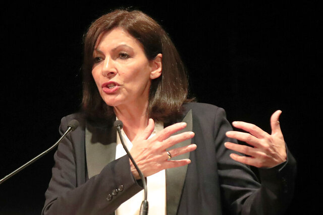 Paris mayor Anne Hidalgo gestures as she speaks during a meeting for the upcoming mayoral elections in Paris Monday, March 2, 2020. France local elections starting March 15, 2020. (AP Photo/Michel Euler)