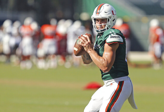 Miami Hurricanes quarterback Tate Martell runs drills during practice at the University of Miami Greentree Practice Field in Coral Gables on Thursday, August 8, 2019.(David Santiago/Miami Herald via AP)