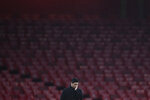 File-This Dec. 13, 2020, file photo shows Arsenal manager Mikel Arteta touching his face during an English Premier League soccer match between Arsenal and Burnley at the Emirates stadium in London, England, Sunday, Dec. 13, 2020. (Laurence Griffiths/Pool via AP, File)
