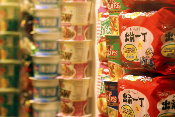 In this frame from video, packets of instant noodles sit on display in the Cup Noodles Museum in Yokohama, Japan, Friday, Aug. 6, 2021. Ramen noodles originated in China and exemplify the creativity and openness to foreign influences of the host country of the 2020 Olympic Games (AP Photo/John Leicester)