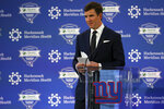 New York Giants NFL football quarterback Eli Manning walks away from the podium after announcing his retirement on Friday, Jan. 24, 2020, in East Rutherford, N.J. (AP Photo/Adam Hunger)