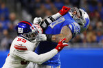 New York Giants linebacker Lorenzo Carter (59) and Detroit Lions offensive tackle Taylor Decker (68) push each other during the first half of an NFL football game, Sunday, Oct. 27, 2019, in Detroit. (AP Photo/Paul Sancya)