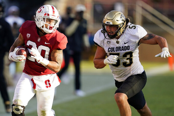 Stanford running back Austin Jones (20) runs against Colorado linebacker Nate Landman (53) during the second half of an NCAA college football game in Stanford, Calif., Saturday, Nov. 14, 2020. (AP Photo/Jeff Chiu)
