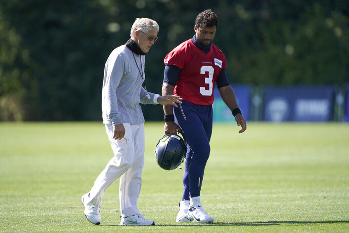 Seattle Seahawks quarterback Russell Wilson (3) walks with head coach Pete Carroll after the last day of NFL football training camp, Thursday, Sept. 3, 2020, in Renton, Wash. (AP Photo/Ted S. Warren)