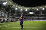 Barcelona's Lionel Messi walks to plays a corner during the Spanish Super Cup semifinal soccer match between Barcelona and Atletico Madrid at King Abdullah stadium in Jiddah, Saudi Arabia, Thursday, Jan. 9, 2020. (AP Photo/Hassan Ammar)
