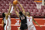 Alabama guard Joshua Primo (11) and Alabama forward Jordan Bruner (2) pressure Western Kentucky center Charles Bassey (23) as he rebounds the ball during the first half of an NCAA college basketball game, Saturday, Dec. 19, 2020, in Tuscaloosa, Ala. (AP Photo/Vasha Hunt)