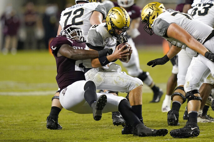 Vanderbilt quarterback Ken Seals (8) is sacked by Texas A&M's Micheal Clemons (2) during the second half of an NCAA college football game Saturday, Sept. 26, 2020, in College Station, Texas. Texas A&M won 17-12. (AP Photo/David J. Phillip)