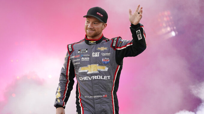 Tyler Reddick waves to the crowd during driver introductions prior to the start of the NASCAR Cup series auto race in Richmond, Va., Saturday, Sept. 11, 2021. (AP Photo/Steve Helber)