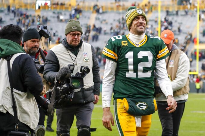 Green Bay Packers' Aaron Rodgers walks off the field after an NFL football game against the Washington Redskins Sunday, Dec. 8, 2019, in Green Bay, Wis. The Packers won 20-15. (AP Photo/Matt Ludtke)