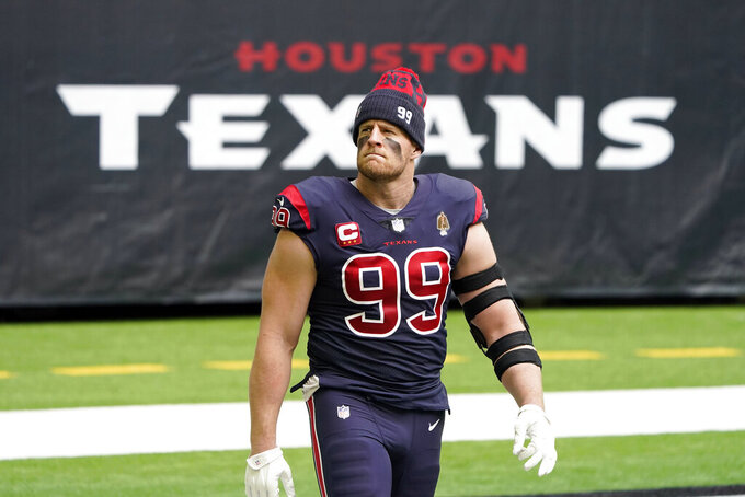 "FILE - In this Dec. 27, 2020, file photo, Houston Texans defensive end J.J. Watt walks on the field before an NFL football game against the Cincinnati Bengals in Houston.  Watt and the Texans have ""mutually agreed to part ways,"" ending the tenure of the face of the franchise and adding another huge change to an offseason filled with upheaval. (AP Photo/Eric Christian Smith, File)"
