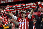 Athletic Bilbao fans celebrate at the end of the Spanish Copa del Rey, quarter final, soccer match between Athletic Bilbao and Barcelona at San Mames stadium in Bilbao, Spain, Thursday, Feb. 6, 2020. Athletic Bilbao won 1-0. (AP Photo/Alvaro Barrientos)
