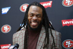 FILE - In this Oct. 20, 2019, file photo, San Francisco 49ers cornerback Richard Sherman speaks at a news conference after an NFL football game against the Washington Redskins, in Landover, Md. Veteran defensive backs and team leaders Richard Sherman of San Francisco and Malcolm Jenkins of Philadelphia are among 32 nominees for the Walter Payton NFL Man of the Year Award. (AP Photo/Alex Brandon, File)