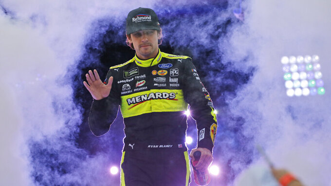 Ryan Blaney greets fans during driver introductions for the NASCAR Monster Energy Cup series auto race at Richmond Raceway in Richmond, Va., Saturday, Sept. 21, 2019. (AP Photo/Steve Helber)
