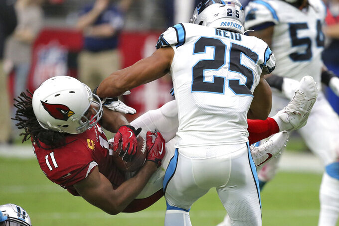Arizona Cardinals wide receiver Larry Fitzgerald (11) is tackled by Carolina Panthers strong safety Eric Reid (25) during the second half of an NFL football game, Sunday, Sept. 22, 2019, in Glendale, Ariz. (AP Photo/Ross D. Franklin)