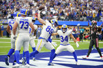Los Angeles Rams tight end Tyler Higbee (89) celebrates after his touchdown catch during the first half of an NFL football game against the Tampa Bay Buccaneers Sunday, Sept. 26, 2021, in Inglewood, Calif. (AP Photo/Jae C. Hong )