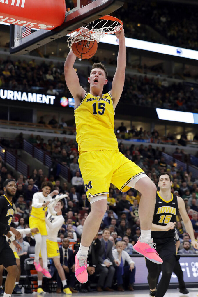 Michigan's Jon Teske (15) dunks during the second half of an NCAA college basketball game against Iowa in the quarterfinals of the Big Ten Conference tournament, Friday, March 15, 2019, in Chicago. (AP Photo/Nam Y. Huh)