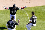 Chicago White Sox's Yasmani Grandal, center, celebrates his game winning single with Yermin Mercedes, left, and Danny Mendick, right, during the 10th inning of a baseball game against the Tampa Bay Rays Wednesday, June 16, 2021, in Chicago. (AP Photo/Charles Rex Arbogast)