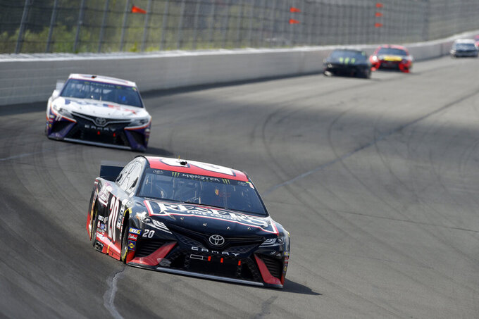 Erik Jones (20) drives through Turn 1 during a NASCAR Cup Series auto race, Sunday, July 28, 2019, in Long Pond, Pa. Denny Hamlin won the race. (AP Photo/Derik Hamilton)