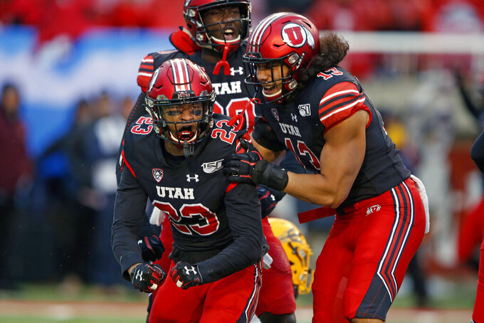 FILE - In this Oct. 19, 2019, file photo, Utah's Julian Blackmon (23) and Francis Bernard (13) celebrate after a play against Arizona State during the first half of an NCAA college football game, Blackmon was selected to The Associated Press All-Pac 12 Conference team, Thursday, Dec. 12, 2019. (AP Photo/Rick Bowmer, File)