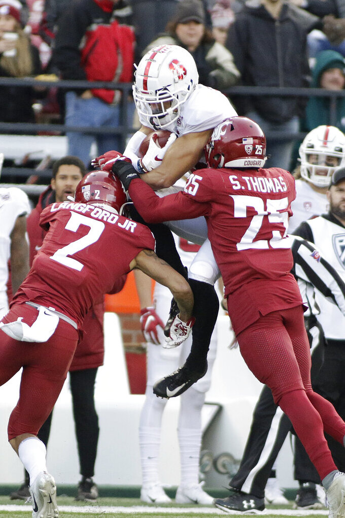 Washington State cornerback Derrick Langford, left, and defensive back Skyler Thomas, right, tackle Stanford wide receiver Osiris St. Brown during the second half of an NCAA college football game in Pullman, Wash., Saturday, Nov. 16, 2019. Washington State won 49-22. (AP Photo/Young Kwak)