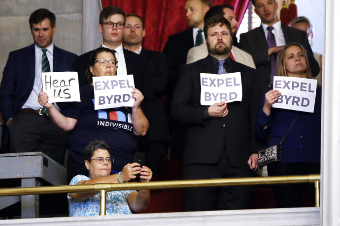 Demonstrators call for the expulsion of Rep. David Byrd, R-Waynesboro, during a special session of the House of Representatives Friday, Aug. 23, 2019, in Nashville, Tenn. Byrd is accused of sexual misconduct by three women nearly 30 years ago. (AP Photo/Mark Humphrey)