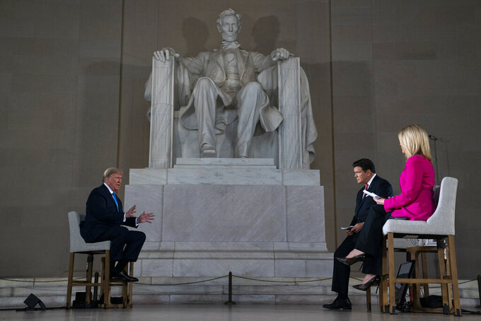 President Donald Trump speaks during a Fox News virtual town hall from the Lincoln Memorial, Sunday, May 3, 2020, in Washington. (AP Photo/Evan Vucci)
