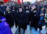 Iranian Shiite pilgrims perform their rituals around the holy shrine of Imam Hussein ahead of the Arbaeen festival in Karbala, Iraq, Friday, Oct. 18, 2019. The holiday marks the end of the forty day mourning period after the anniversary of the martyrdom of Imam Hussein, the Prophet Muhammad's grandson in the 7th century. (AP Photo/Hadi Mizban)